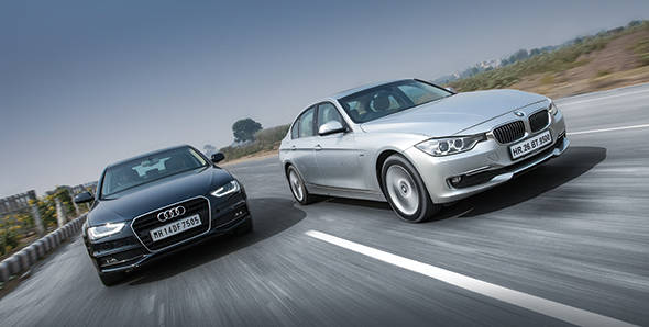 Comparo - 2012 BMW 3 Series vs Audi A4 in India