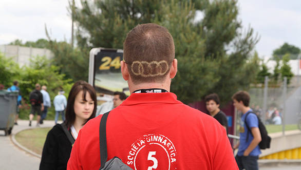 A Le Mans crazy fan with the four Audi rings as his hairstyle