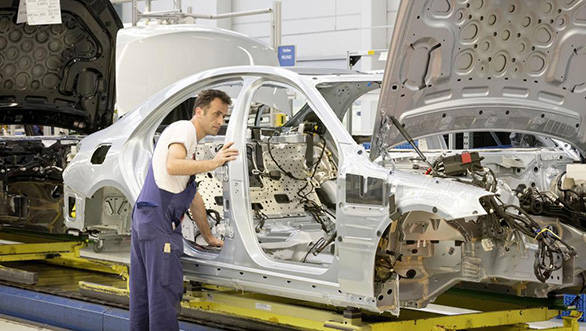 A worker working on the S-Class' body