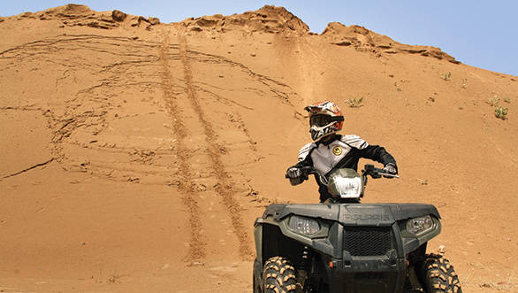 an atv is not like a motorcycle where slight pressure on the handlebar will have you leaning  into the corner