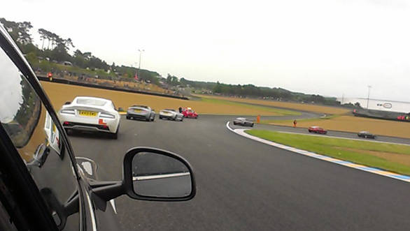 View from the Rapide as  the fleet of Astons head out on to the Le Mans circuit
