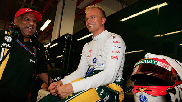 Tony shares a lighter moment with Heikki Kovalainen
