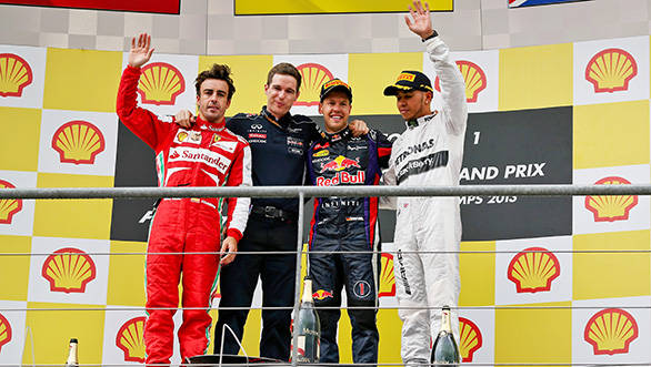 Fernando Alonso, Michael Manning---Red Bull's chief of trackside operations, Sebastian Vettel and Lewis Hamilton on the podium at Spa