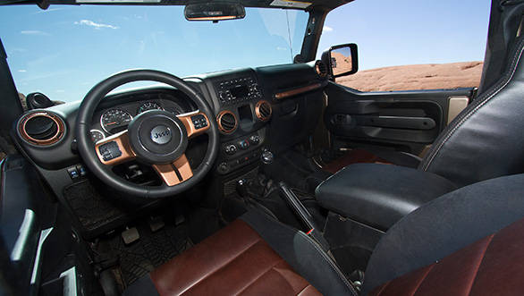 In keeping with the butch custom theme, the interior layout is done in a fetching upmarket brown and black colour scheme