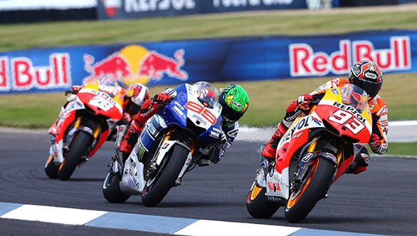 Marquez blitzed past Pedrosa (left) and Lorenzo (centre) to win at Indianapolis