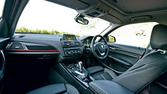 The BMW Sport Plus variant features all-black leather interiors and sporty red and piano black detailing