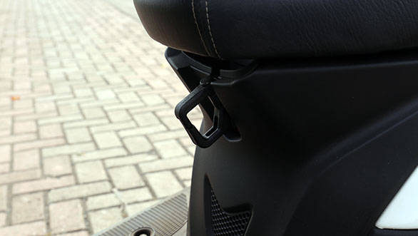 The other bag hook is positioned under the pivot point of the seat ? that can be folded away when not in use