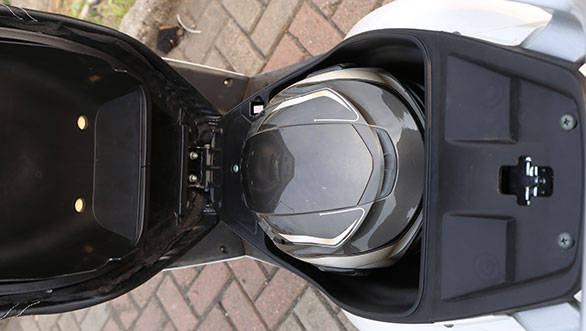 The 17 litre under seat storage was large enough to take a half face helmet