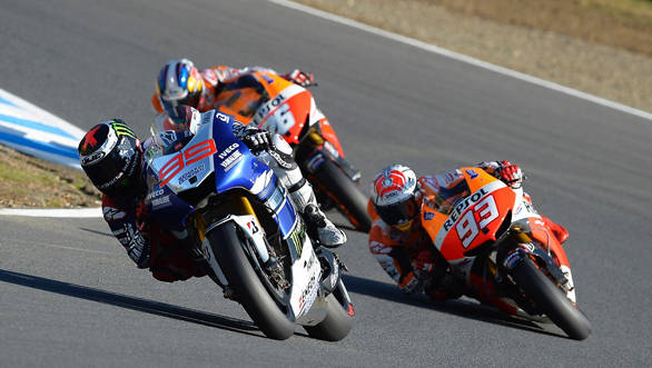 Lorenzo leads a charging Marquez and Pedrosa