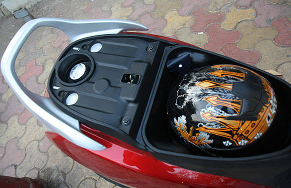 The underseat storage offers a litre more than the Jupiter's but can still hold only a half face helmet