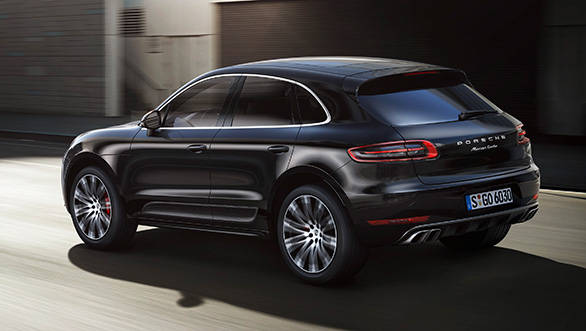 The long black roof spoiler adds to the Macan's flowing design