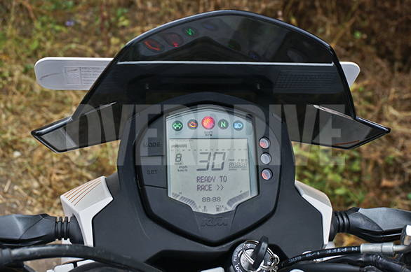 The digital meters have everything. This one wears a Rs 2,500 accessory tall visor