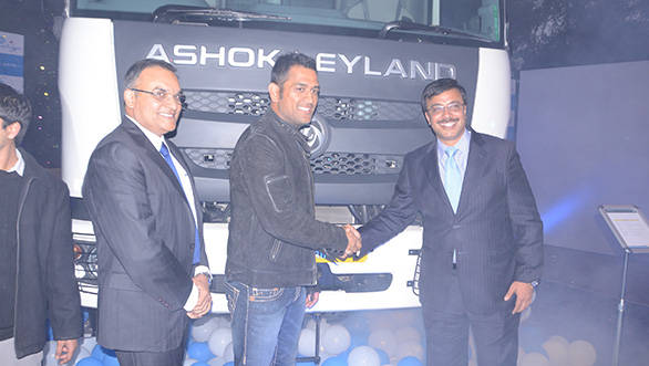 Ashok Leyland officials and Mahendra Singh Dhoni with the new Captain series trucks