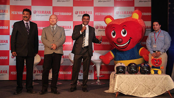 Yamaha India officials with the YCSP mascot and helmets
