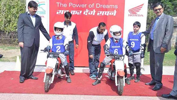 Honda trainers instructing kids