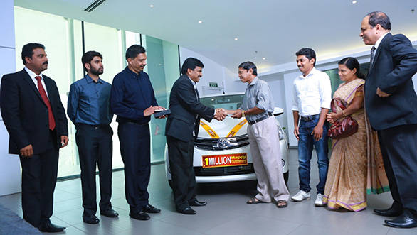 TKM officials handing over the keys of the one millionth vehicle to the customer