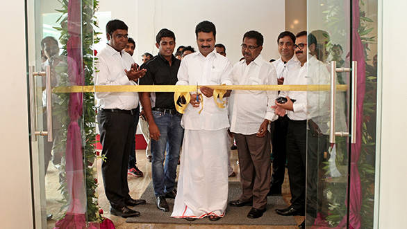 Kochi's Mayor Mr. Tony Chammani cuts the ribbon during the opening ceremony of the dealership