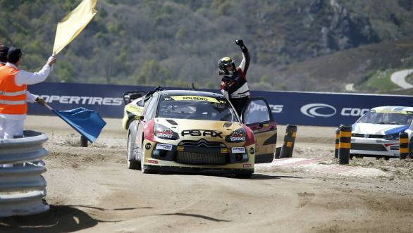 An ecstatic Petter Solberg took the winners trophy at Portugal