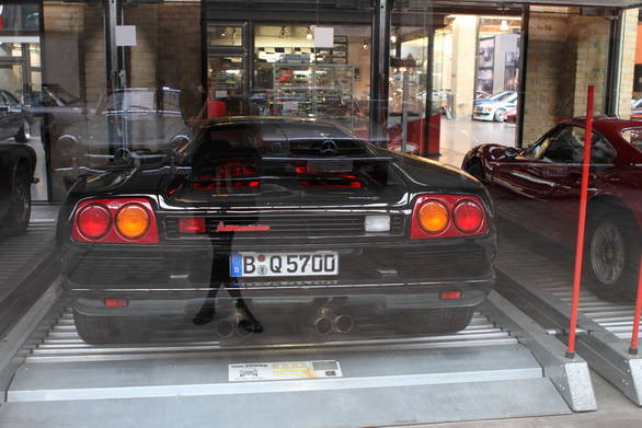 Owners can store their cars in glass cases to protect them from the elements - like this Lamborghini Diablo and that Ferrari Dino you see peeking out the corner