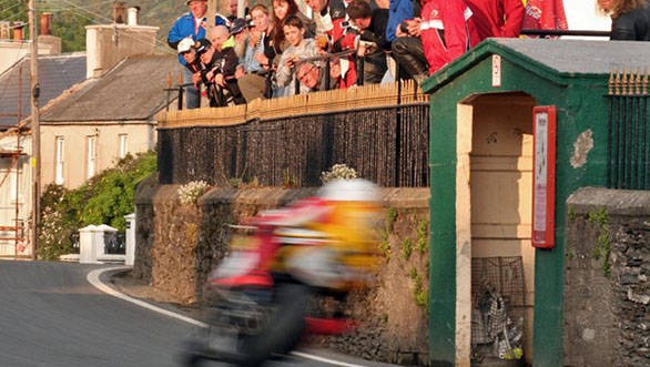 The blur you see there is Guy Martin, and one false move means he will be in the hay bales and crowd. Typical IOMTT, then!