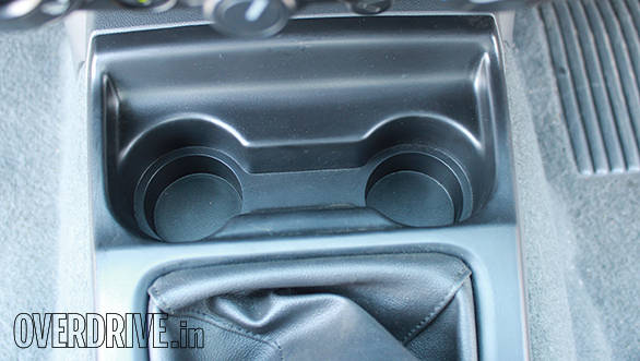 Front cup-holders are placed below the centre console