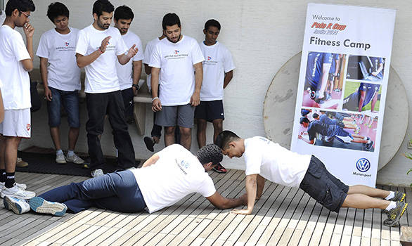 Compressed--Volkswagen-Race-Polo-drivers-doing-pushups