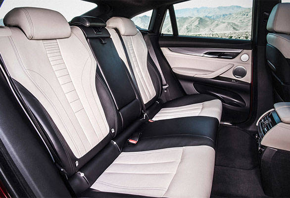 Generous legroom at the rear, however, the coupe style sloping roofline will eat into head room