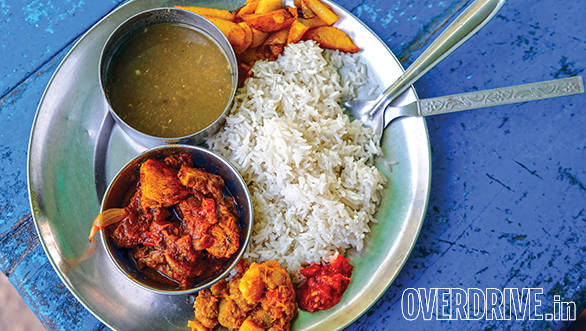 We stopped at a quaint little roadside dhaba that is actually a family house with a table out front for customers. We got to experience a typical Nepalese meal of dal-bhat and chicken, freshly made and piping hot