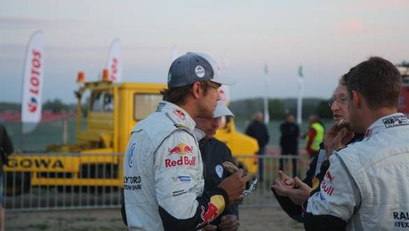 Andreas Mikkelson chews the fat and chews a sandwich at the same time - regular multitaskers these rally drivers! He ended the day 2.8 seconds off team-mate Ogier