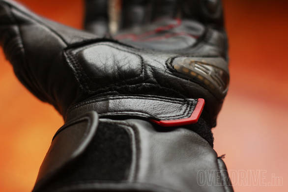 These gloves have a two-stage retension system - a velcro band (with the red tab) as well as bigger velcro flap