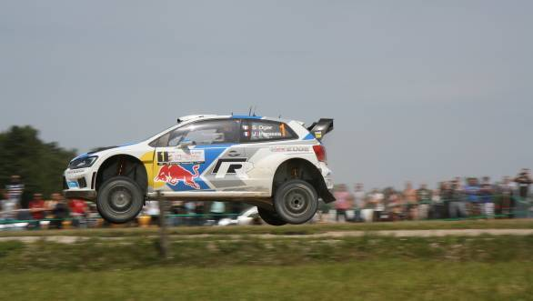 The Volkswagen Polo R WRC of Sebastien Ogier and Julien Ingrassia airborne at the Goldap stage