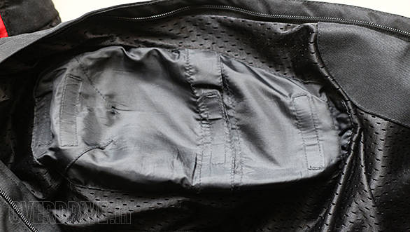 This is a pocket for knee armour. Note the multiple strips of velcro seen as stithing - that is how adjust the height of the armour to it sits correctly on the knee.