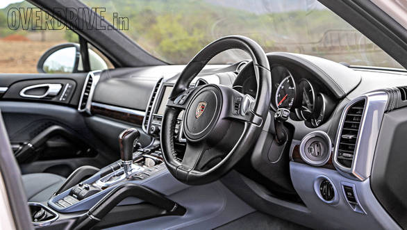 The Porsche has a more luxurious and sporting interior  but with a rather busy centre console peppered with plenty of buttons