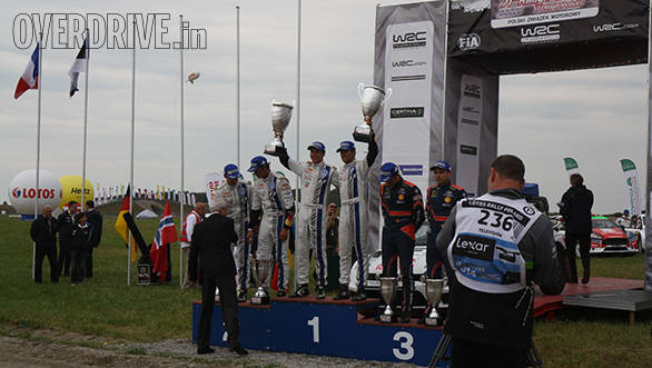 The podium at Mikolajki - Ogier and Ingrassia, Mikkelson and Ola Floene, Neuville and Nicolas Gilsoul
