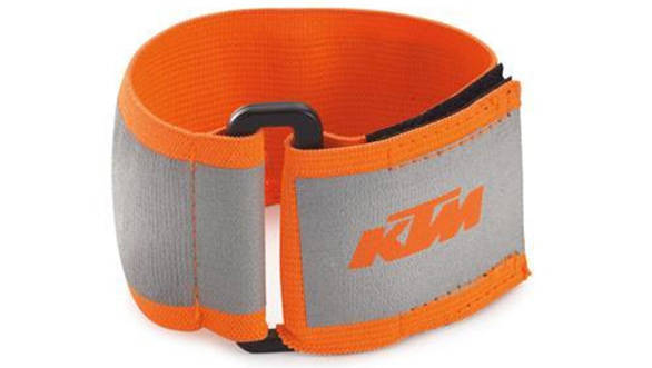 This is a KTM-branded arm band where all the silver-grey areas light up a bright white under headlights. I use these to secure my knee armour as well as increase my visibility