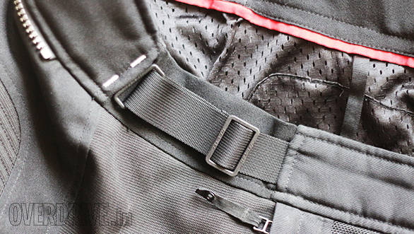 Most motorcycle pants accommodate a range of waist sizes to allow for good eating as well as layering in bad or cold weather. On this pair (Rev'it Airwave), the buckle slides to create more or less space. The black panel behind the webbing and buckle stretches