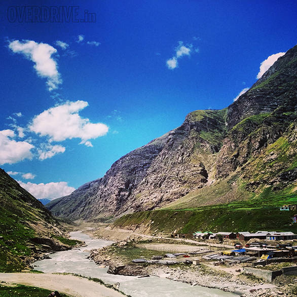 The road runs along the river for a long time after you climb down from Rohtang. This valley is emerald green and is one of the most amazingly visual stretches of the climb to Leh. Soon, all the green will be gone and you'll be well above the vegetation line