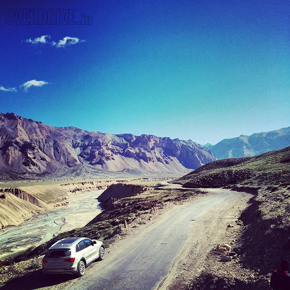 Approaching the Sarchu plain, the river carves quite the vista of sand scultures and the road runs along it. You're torn between zipping through the lovely valley and stopping to capture the scene