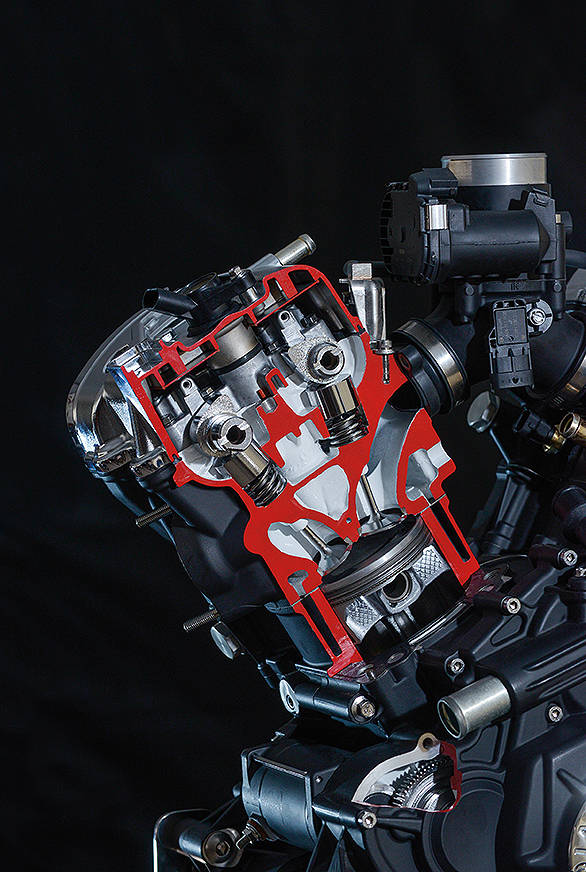 Here is a cutaway detail of the engine. You can clearly see the DOHC layout as well as two of the four valves above the piston. The engine is a relatively high compression unit at 9.5:1 by cruiser standards and boasts closed-loop fuel injection