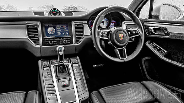 Interior defines luxury while fit and finish is top notch. New design three-spoke steering is great to grip. 7-inch touchscreen displays a lot of info. Note analogue stopwatch part of the sport chrono package