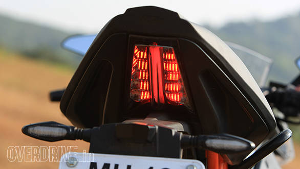 Neatly integrated tail lamps use a thin central Led line as a running tail lamp. Two brighter LEDs flank this line to make a distinctive tail lamp. The countersunk handholds are beside the tail lamp on either side
