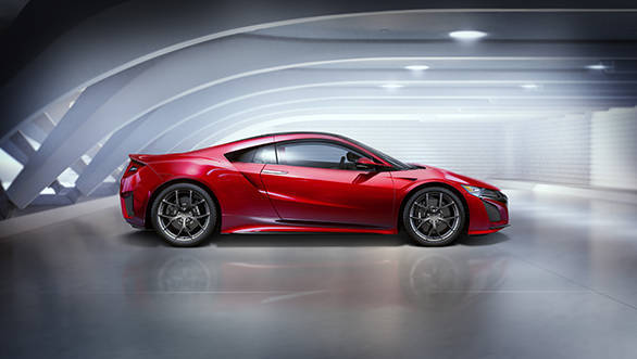 The body features classic low and wide proportions, sharply contoured surfaces, an aggressive front design, and tail lights that pay homage to the original NSX.