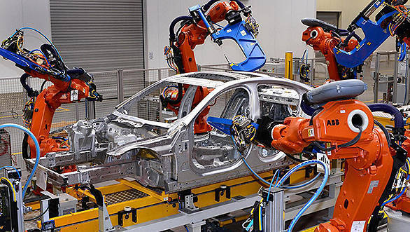 Jaguar-XE-enters-production-robot-assembly