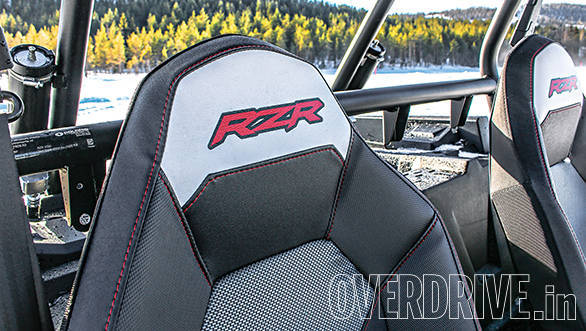 Racecar style bucket seats hold you in place. . .