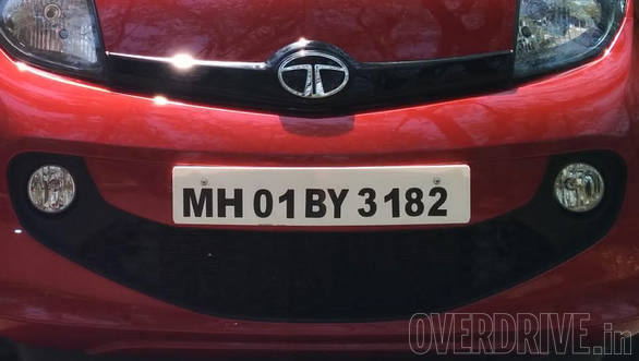 Tata loves smiley grilles and the face gets one too. It also integrates round fog lights. Also notice the gloss-black applique on the nose, bearing the Tata logo