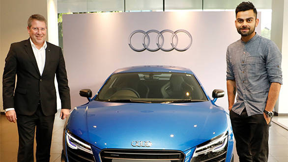 Joe King, Head Audi India delivers the limited edition Audi R8 LMX to Ace Cricketer virat Kohli 1