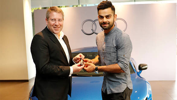 Joe King, Head Audi India delivers the limited edition Audi R8 LMX to Ace Cricketer virat Kohli 2