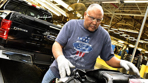 CLAYCOMO, MO. March 13, 2015--Ford Motor Company team member, Ronald Wolfskill inspects the all-new Ford F-150 at Ford'??s Kansas City Assembly Plant.  Ford celebrated Job One, the official start of production of the toughest, smartest, most capable, F-150 ever.  Photo by: Sam VarnHagen