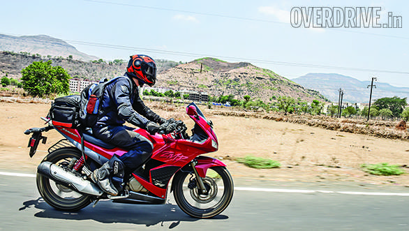 The Hero is a long motorcycle - look how Rishaad's backpack fits neatly ahead of the tail bag