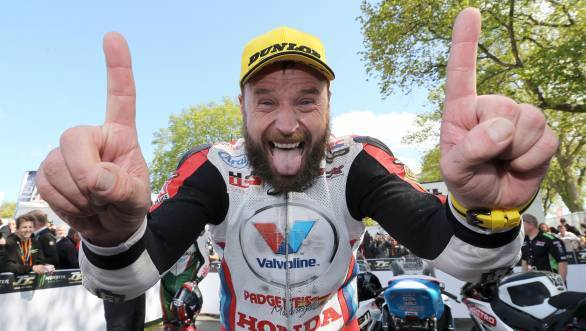 All smiles is Anstey, having prevented Ian Hutchinson from taking his tenth Superbike TT win